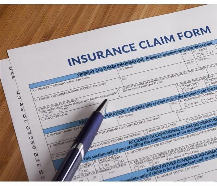 Insurance claim form waiting to be fill out, pen on top of form